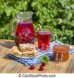 Jam shortbread cookies and red compote with cherries, strawberries, gooseberries, raspberries and apricot jam