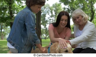 Positive family resting in the park