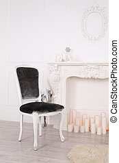 Vintage chair near a large fireplace