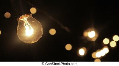 Lamps of garland burning in night - Bright burning lamp...