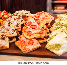 Pizza Take Away pieces on a stall in cafe, Traditional...