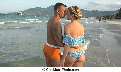 ?ouple kissing at beach. - Attractive young couple kissing...