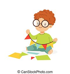 Cute little boy making a garland of pennants, kids creativity, education and child development, colorful character vector Illustration