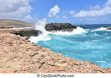 Sea Cliffs with Water Running Down them In Aruba - Rock...