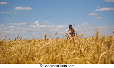 lady comes in wheat field and looks into camera smiling -...