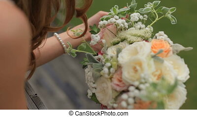Gorgeous bride blonde with a bouquet of flowers - Attractive...