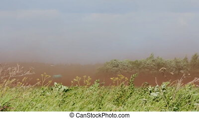 Dust-storm ( dust devil; dust whirl) on agricultural lands....