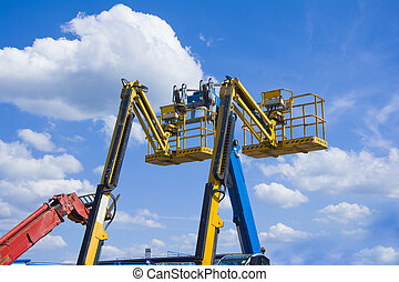 Lift buckets in the blue sky with clouds - Lift buckets boom...