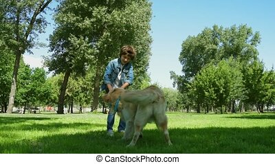Cheerful little boy enjoying time with his dog - Pleasant...