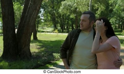 Pleasant loving couple having a walk in the park - Healthy...