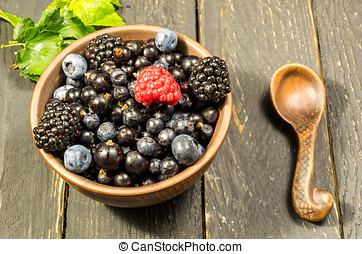Fresh forest berries with a green leaf.