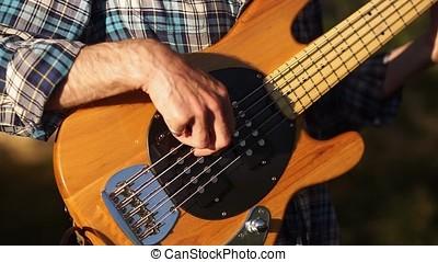 Man playing guitar at a rock concert.