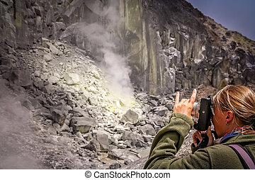 Photographing crater of Gunung Sibayak volcano - Female...