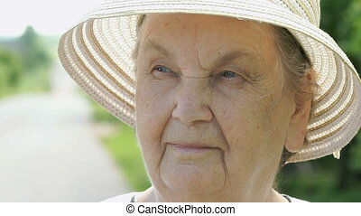 Portrait of elderly woman aged 80s dressed in hat - Portrait...
