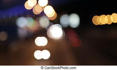 Car bokeh on the night freeway