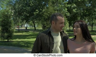 Positive smiling couple having a walk outdoors