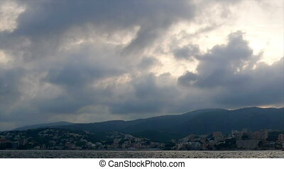 Timelapse clouds sea mountain town - Timelapse of clouds...