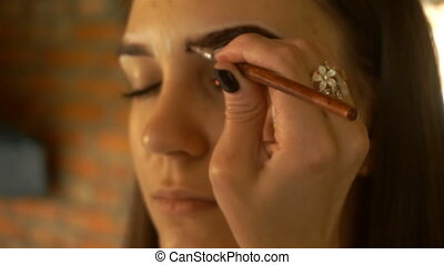 makeup artist paint eyebrows special paint and brush...