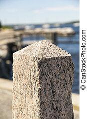 Stone pillar on waterfront - Stone pillar along waterfront...