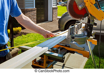 Contractor Using Circular Saw Cutting Crown Moulding for...