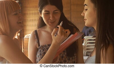 beautiful fun girls dye their eyebrows and talking among...