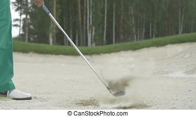 Golf shot in sand. Golf player hits a ball in the sand. Sand...