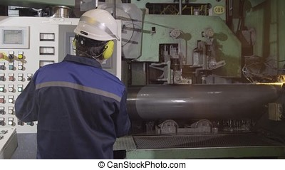 Making metal pipes and tubes in an engineering factory....