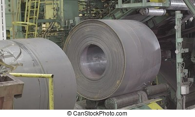 Metal coils machine. The machine at the factory. Machine for...
