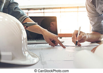 Image of engineer or architectural project, two engineering discussing and working on blueprint with architect equipment, Construction concept