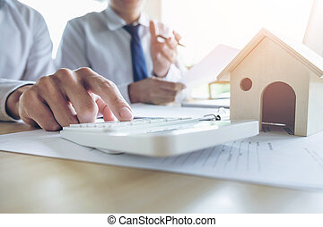 Man sign a home insurance policy on home loans, Agent holds...