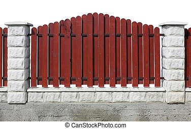 Fragment of a red rural fence isolated