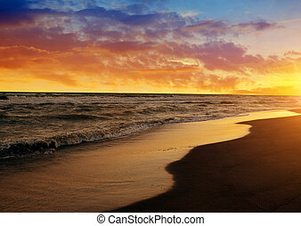 Colorful sunset sky above the sea.