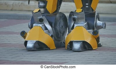 Feet of the foot of the yellow robot. Transformer robot...