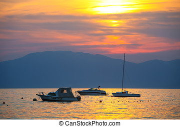 Sunset with boats at sea