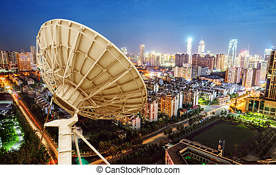 Satellite antenna and urban landscape - City night view and...