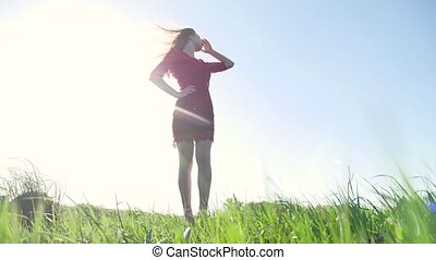 girl nature wind. girl is standing in the field of grass green. lifestyle woman freedom