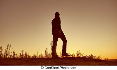 Man travel silhouette. Man shows his hand in the distance...