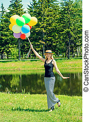 lady with balloons - Happy summer day. Pretty elegant young...