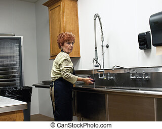 Senior Woman working in Industrial Kitchen