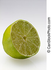 "Sliced isolated green lemon (lat. Citrus) - ""Eureka"""