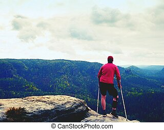 Hurts hiker with knee brace features. Man with leg in join...