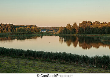 Lithuanian rural scenery in the evening - Lake during the...