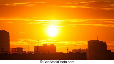 Silhouette of city on sunset background.Time Lapse.