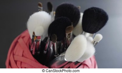 Make up brushes on table. Cosmetics products