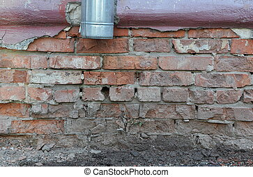 Crushed brick wall with downpipe - Building facade close-up...