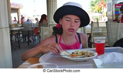 Girl teen eats at a cafe. Girl teenager eating lunch delicious outdoor food