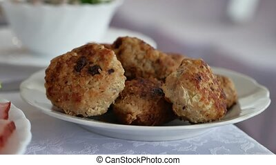 Homemade cutlets with oatmeal on a wooden table in a rustic...