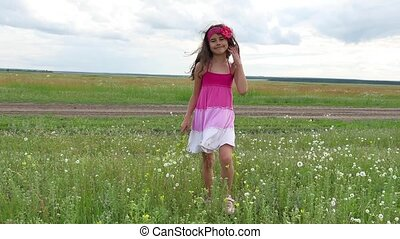 Girl teenager with flowers goes to field nature. Summer...