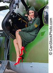 Old-timer helicopter and sexy soldier - Happy pin-up model...