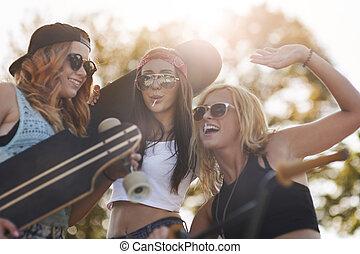 Cheerful teenagers in the skatepark